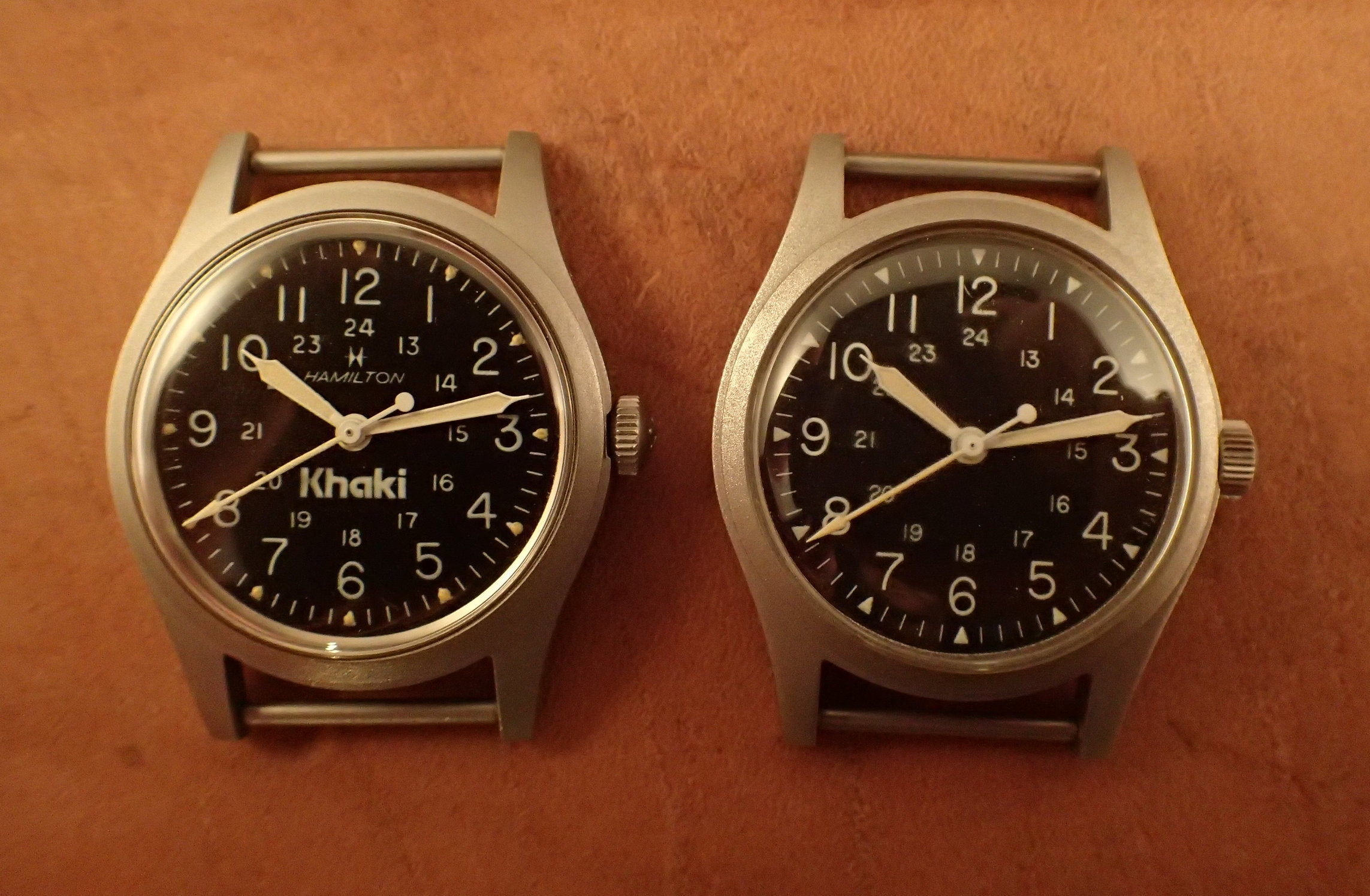 """The """"GG-W-113A"""" 9219 and actual GG-W-113 watches together. Note the different crowns; otherwise these two are identical."""