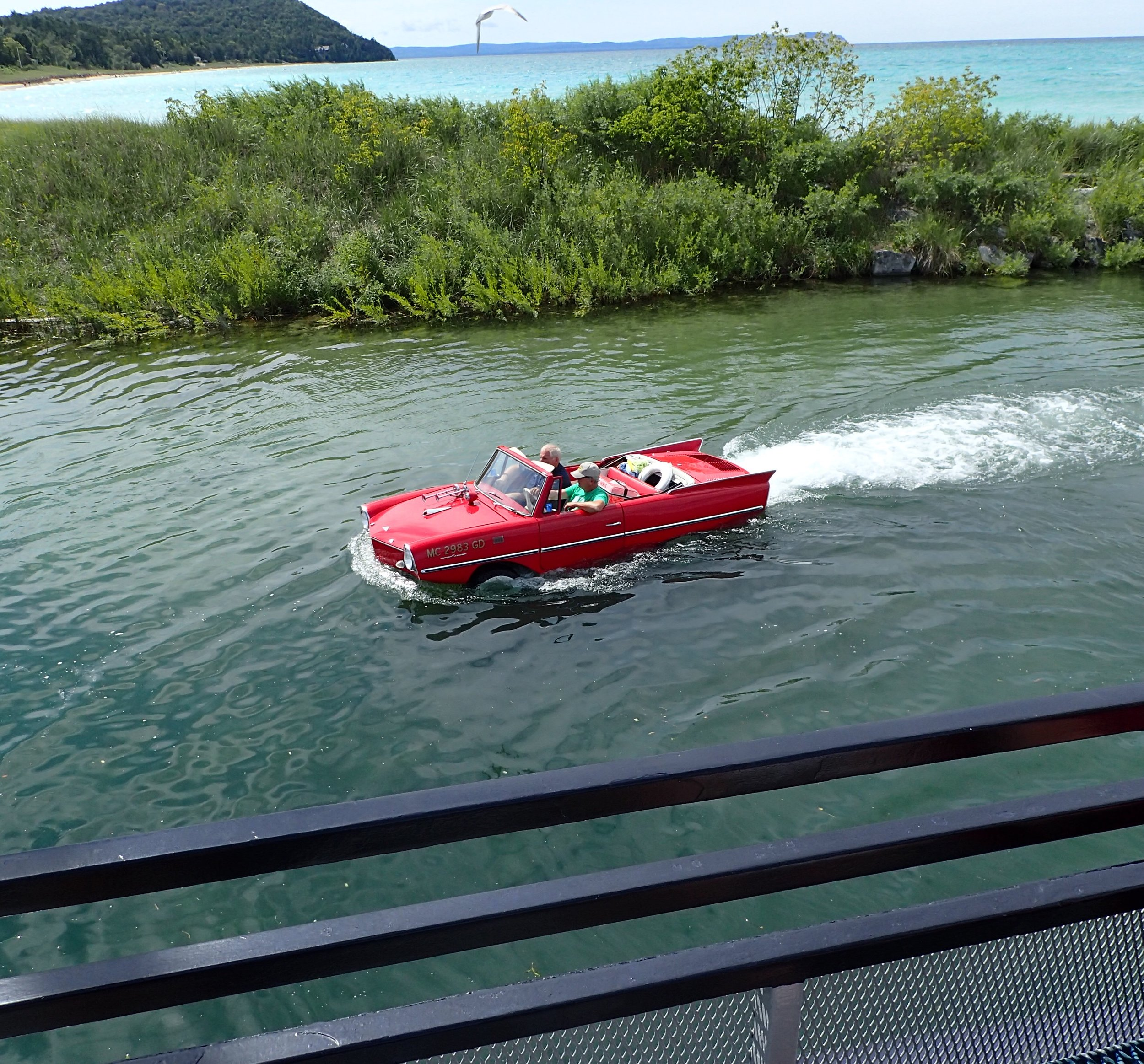 The Amphicar cruising by our docked ferry prior to our departure.
