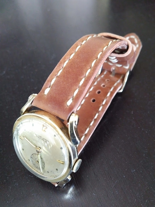 A vintage Ulysse Nardin on Natural Arts & Crafts strap. Look at those beautiful lugs!