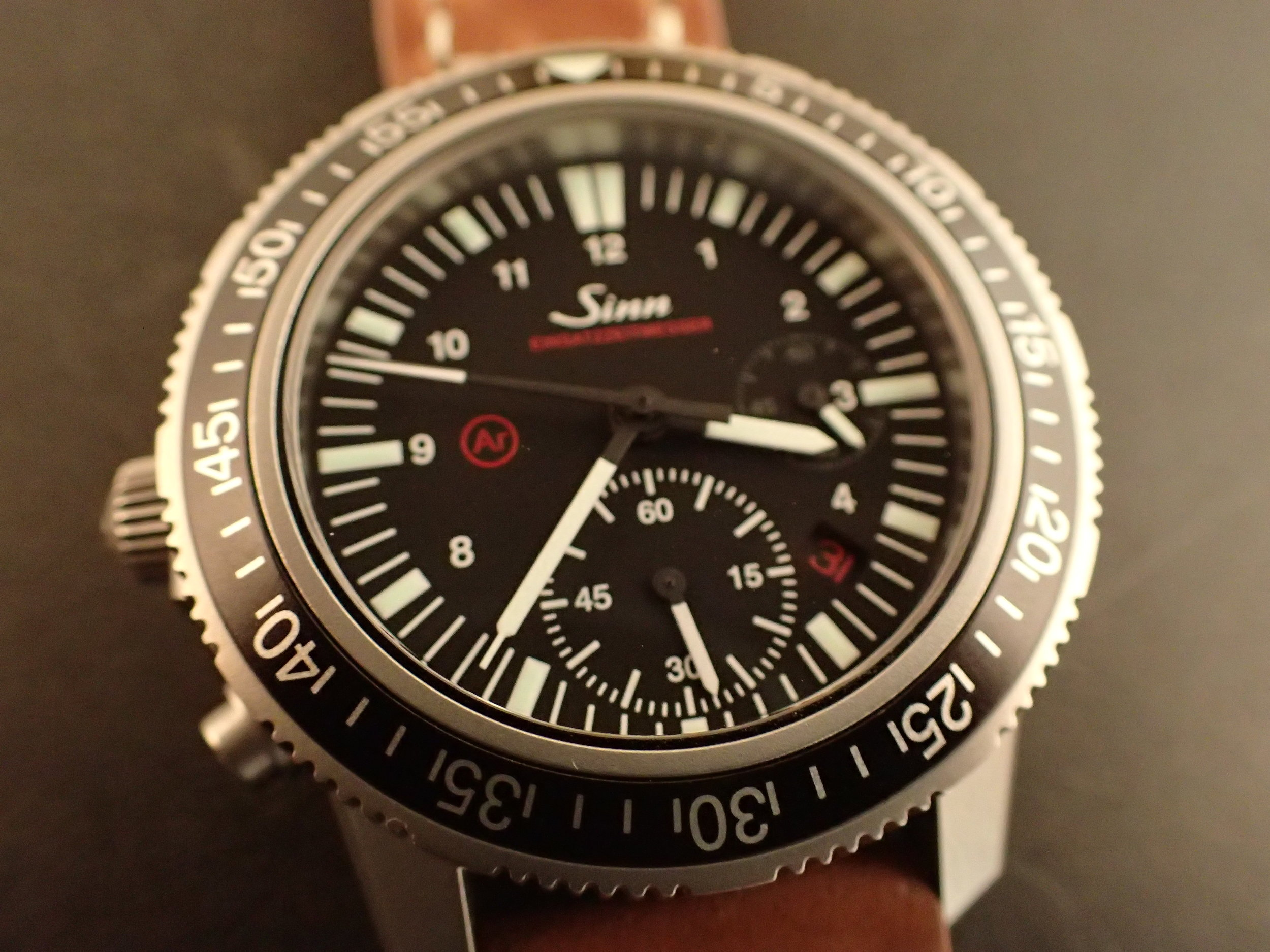 A defining and unusual characteristic of the Sinn 613 is the 60-minute chronograph located at 6:00.
