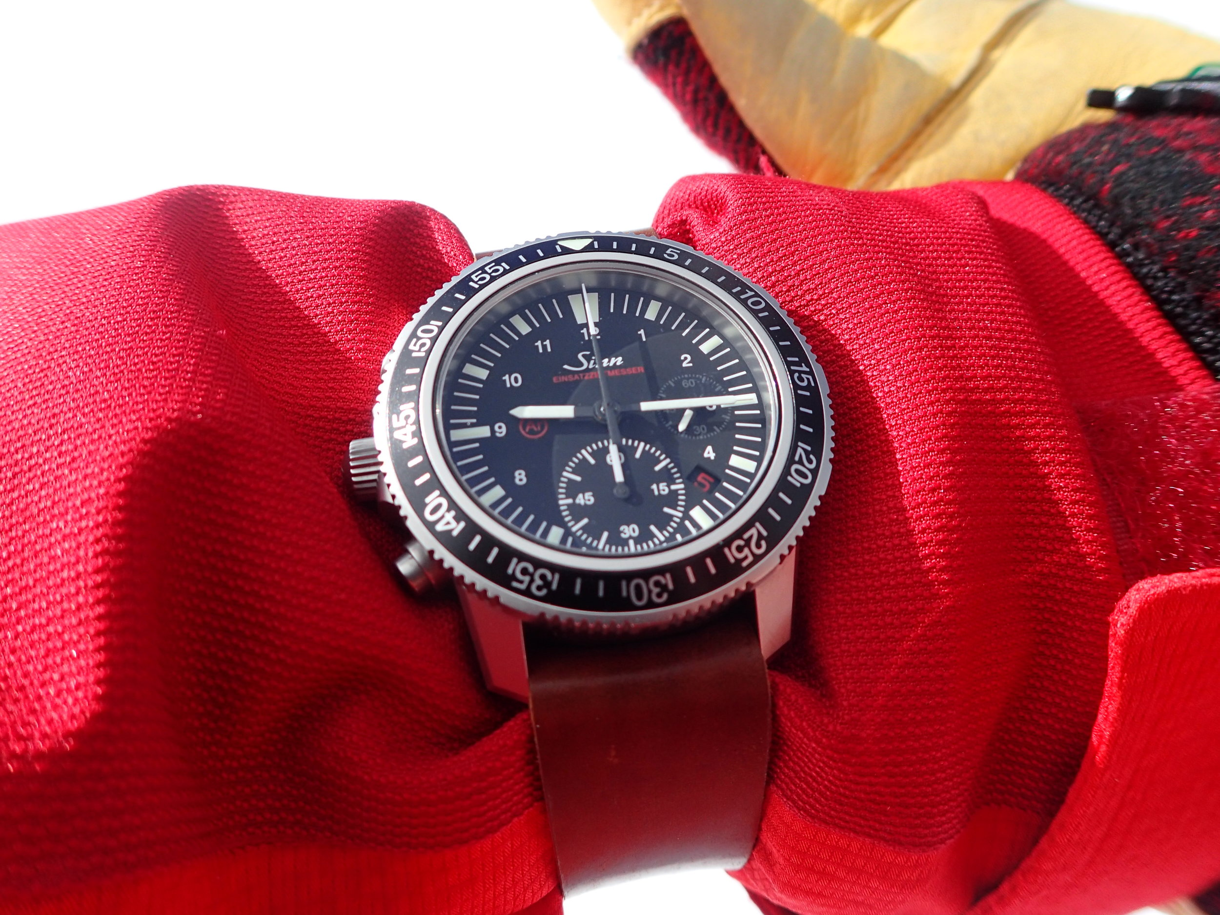 An extra-long one-piece strap makes it easy to wear the Sinn over a coat sleeve.