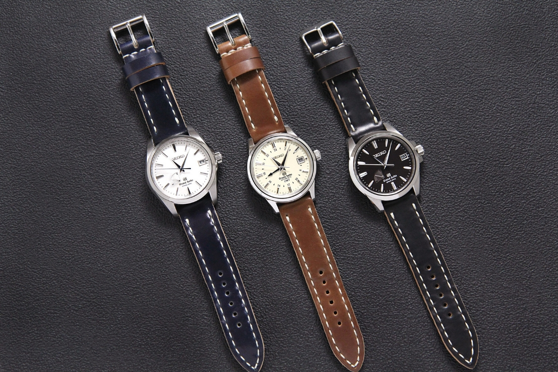 A spectacular trio of Grand Seikos on Arts & Crafts straps in Navy, Mahogany, and Black. Wow!