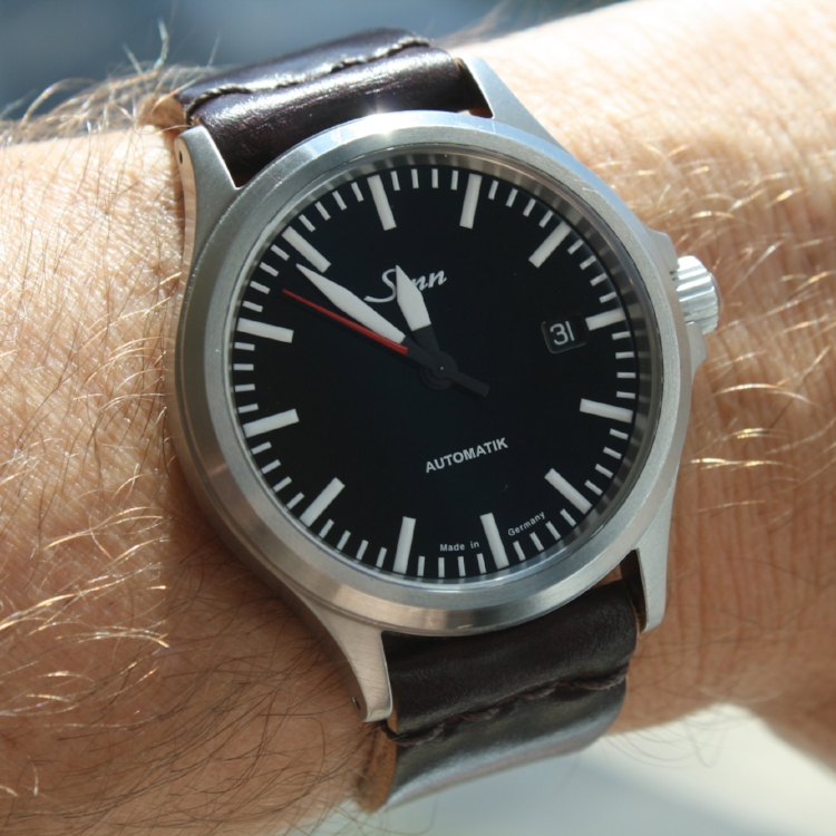 The very special Sinn 556 red seconds edition on a two-piece. This watch is a Rover Haven Favorite!