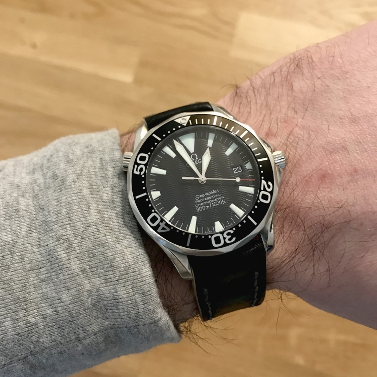 Seamaster 2254 on a Black Arts & Crafts with steel gray stitching. This watch is an absolute classic!