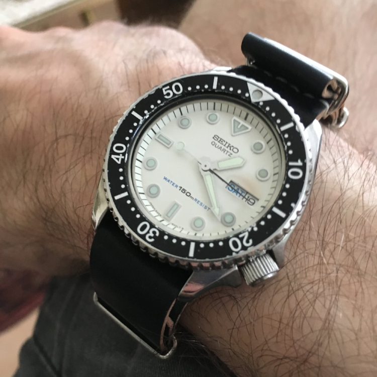 A rare white-dialed Seiko diver on 19 mm Black MIL strap. Well done!
