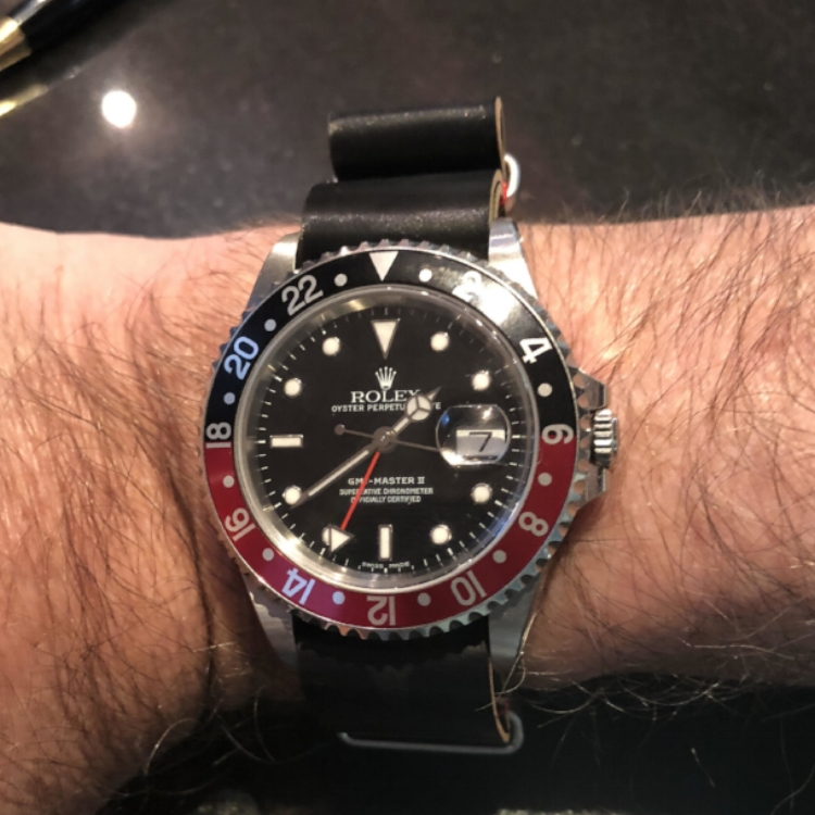 GMT Master II on a Black MIL strap with coordinating red stitching. Seriously cool stuff!