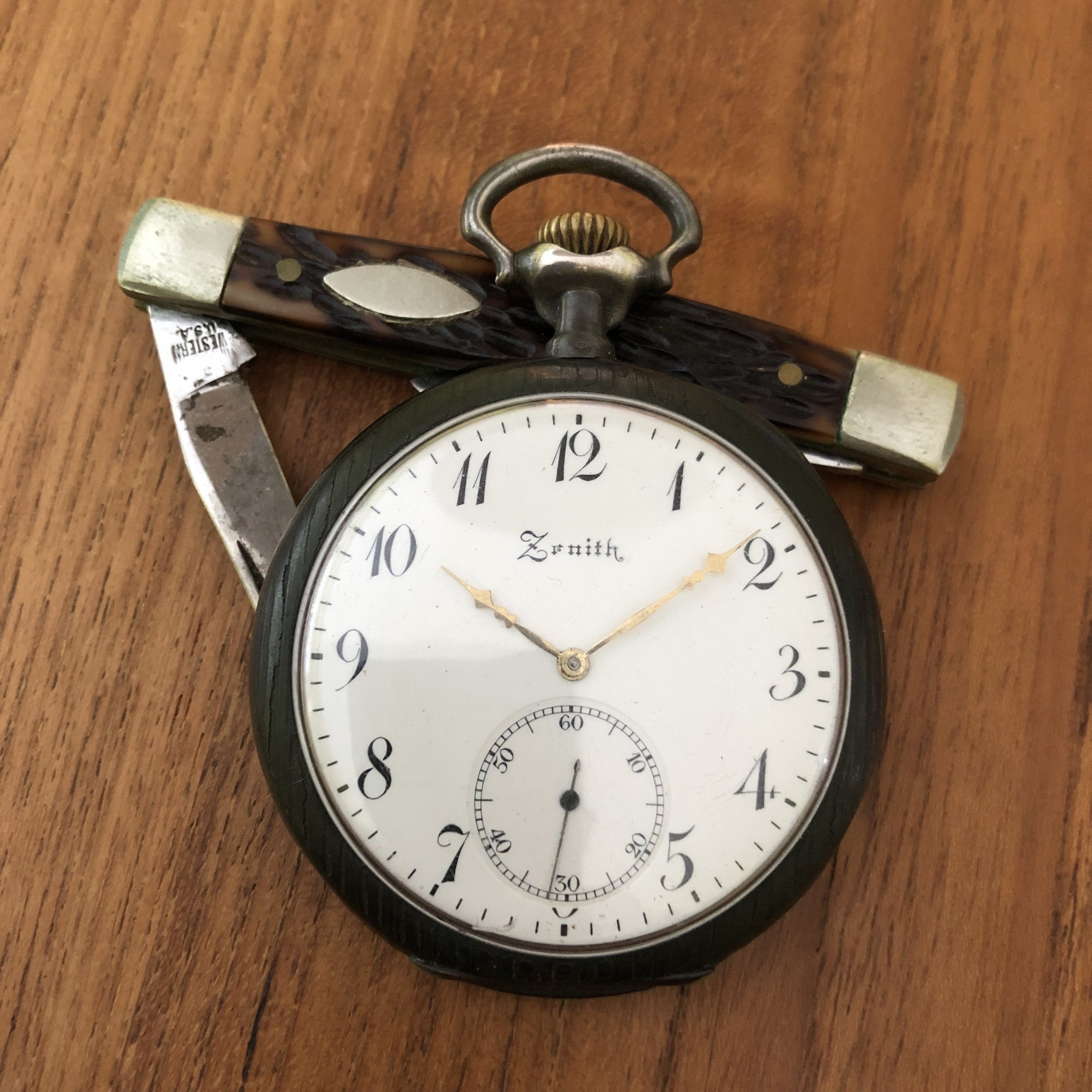 My grandfather's pocket watch and his dime store Western pocket knife, which I found while researching this article.