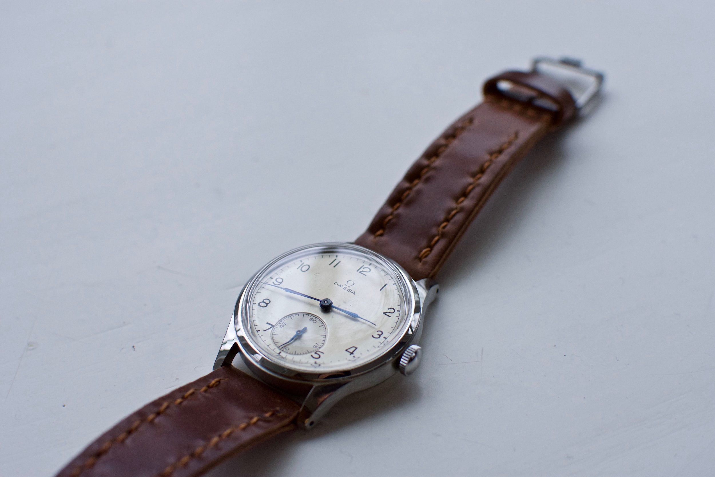 A vintage Omega small seconds on a Cognac Arts & Crafts. All-time classic.