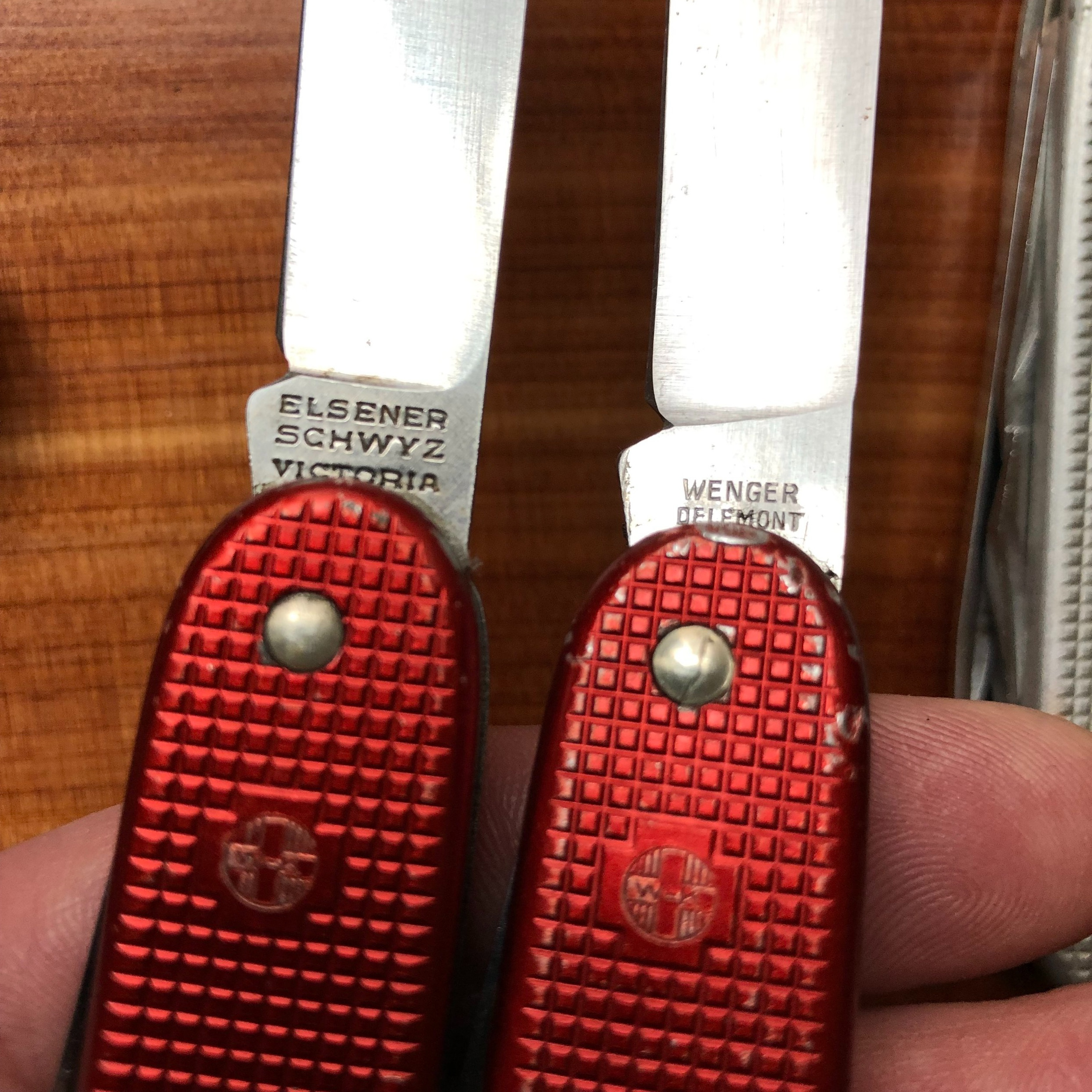 Tang stamps of Victorinox (L) and Wenger (R) version 1 SAKs.