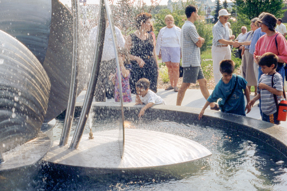 Children play in fountain