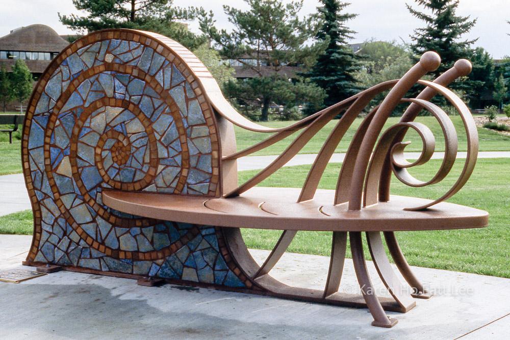 Snail bench in Celebration Garden