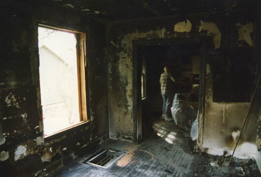 A photo of me walking through our 35th St. duplex after the fire. March 31, 1996