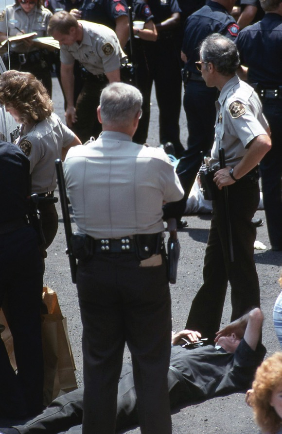 A Catholic priest going limp before his arrest.