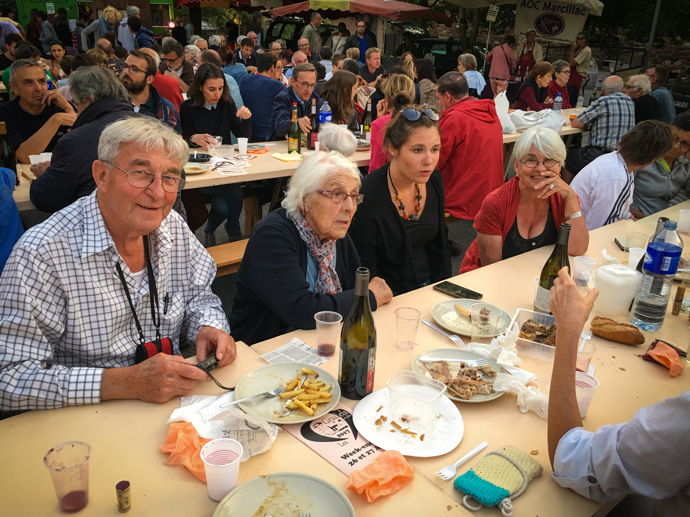 Gerry having dinner and fun at Valady's marché gourmand. On Gerry's left are Suzanne (Véronique's aunt), Héloise (a great cousin), Elizabeth (one of Véronique's cousin), as well as lots of locals having great times. Véronique is across the table.