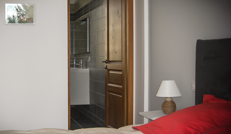 One bedroom and entrance to its own en-suite full bathroom