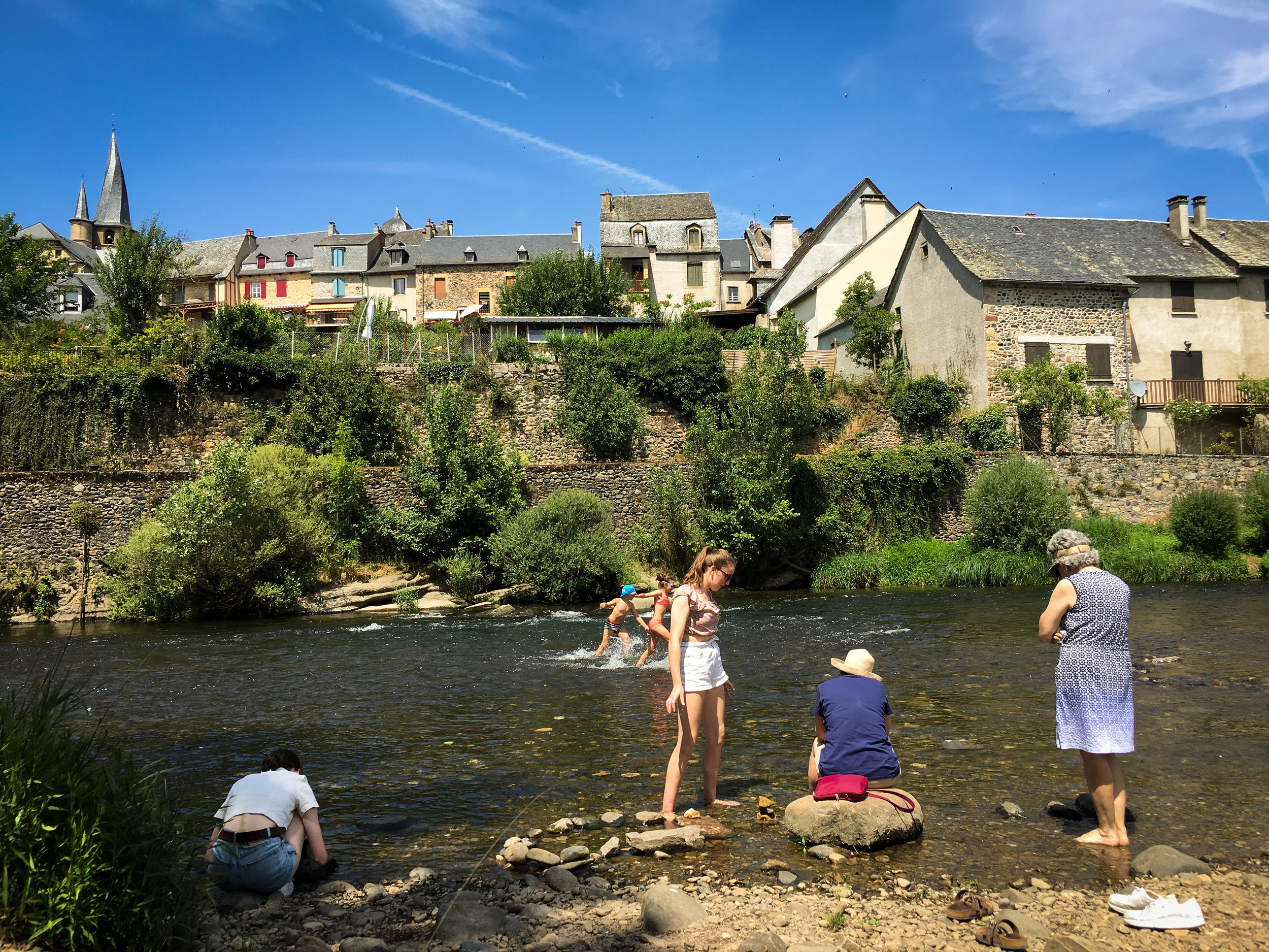 Kayla, Sophie, Kellie and Sarah having some fresh good times by the Lot river at Saint-Côme d'Olt on a very hot day. It is to note Saint-Côme d'Olt is one of the ten (yes 10 out of 90 or so in France!) most beautiful villages found in Aveyron. The twisted spire of the church is a masterpiece of carpentry and architecture.
