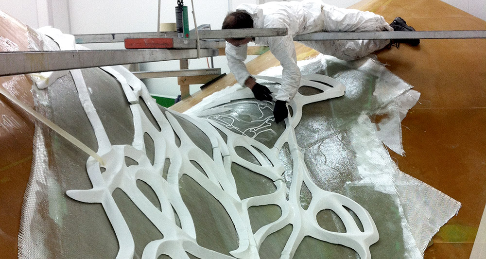 placing the foam bodies on the fibreglass surface