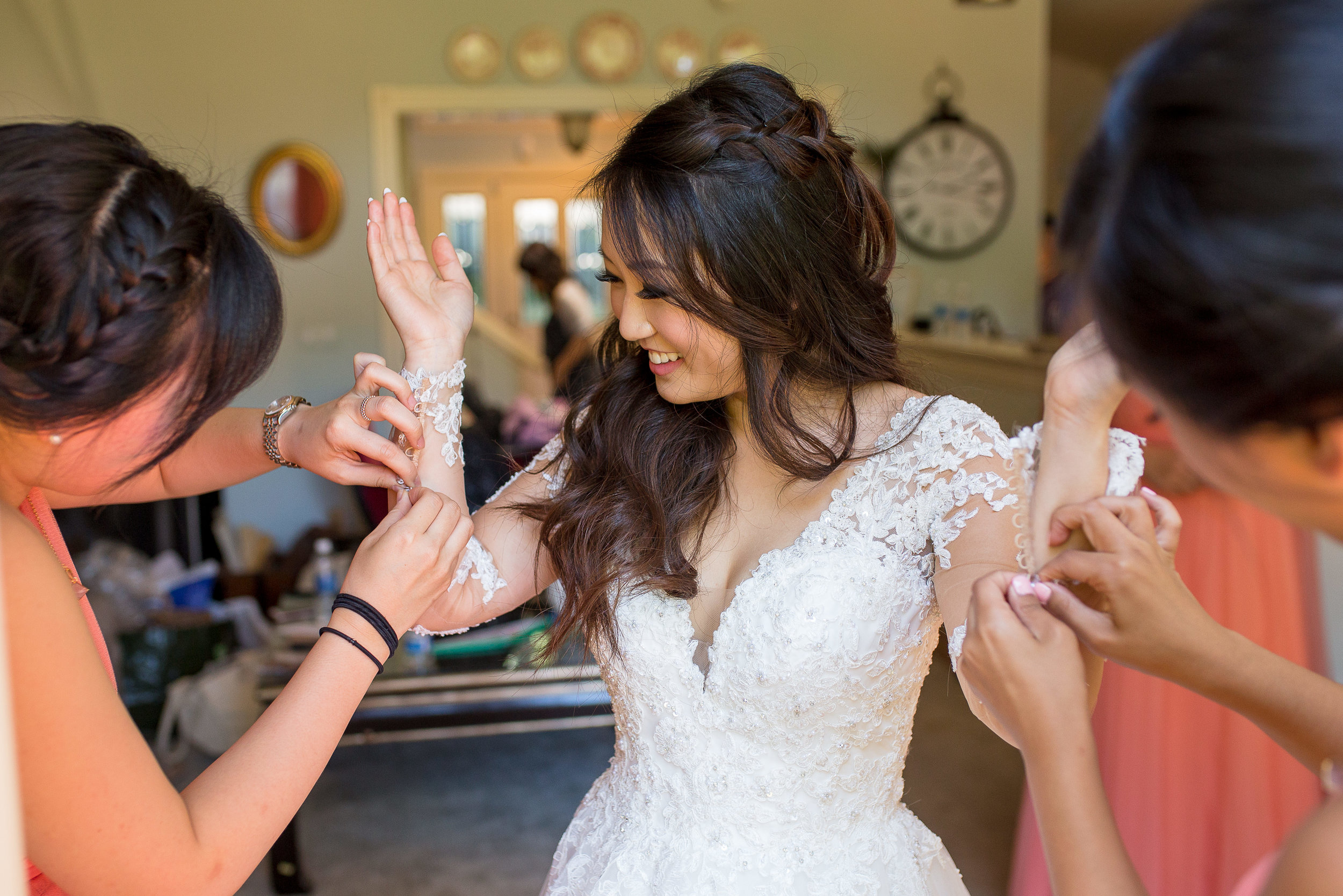 Maybe it doesn't take 2 to button up your sleeves, but why not when you have your bridesmaids there to help?