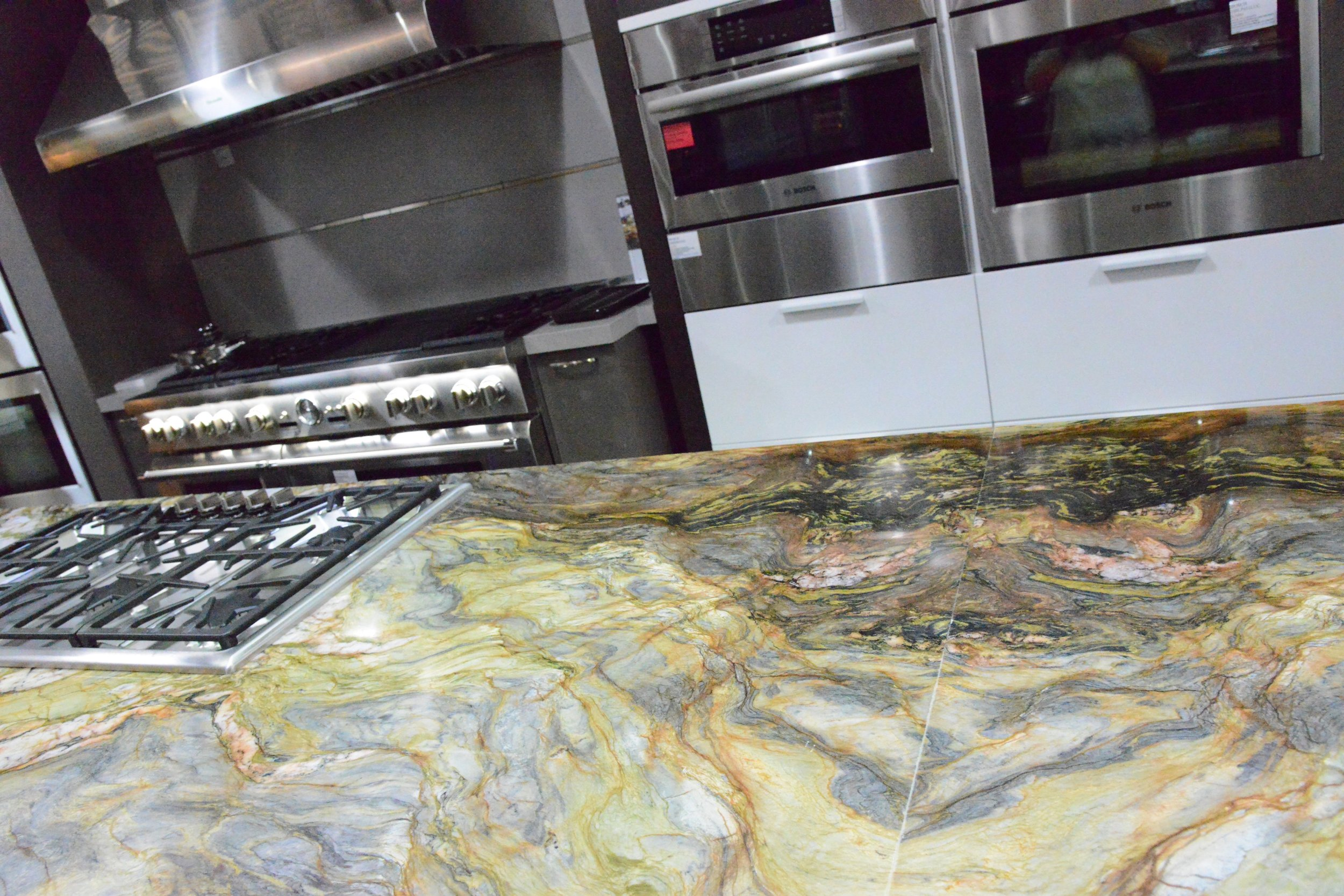 Capital Distributing  chose natural stone for their new live  Thermador  kitchen Photo:  Lisa Stewart Photography