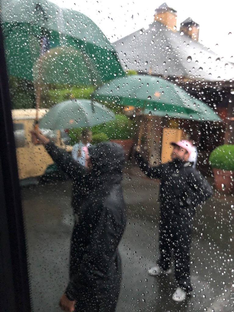 Employees of Auberge du Soleil line up to keep us dry when we arrive