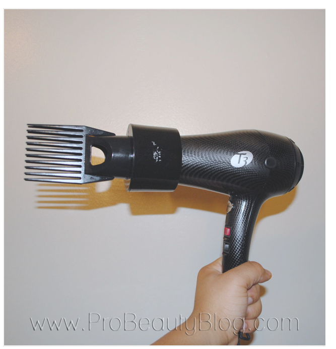Blow dryer with comb attachment.