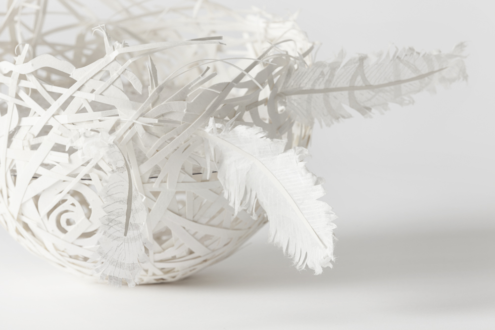 Nest Egg with lace and feathers  By  Roma McLaughlin , papercut artist