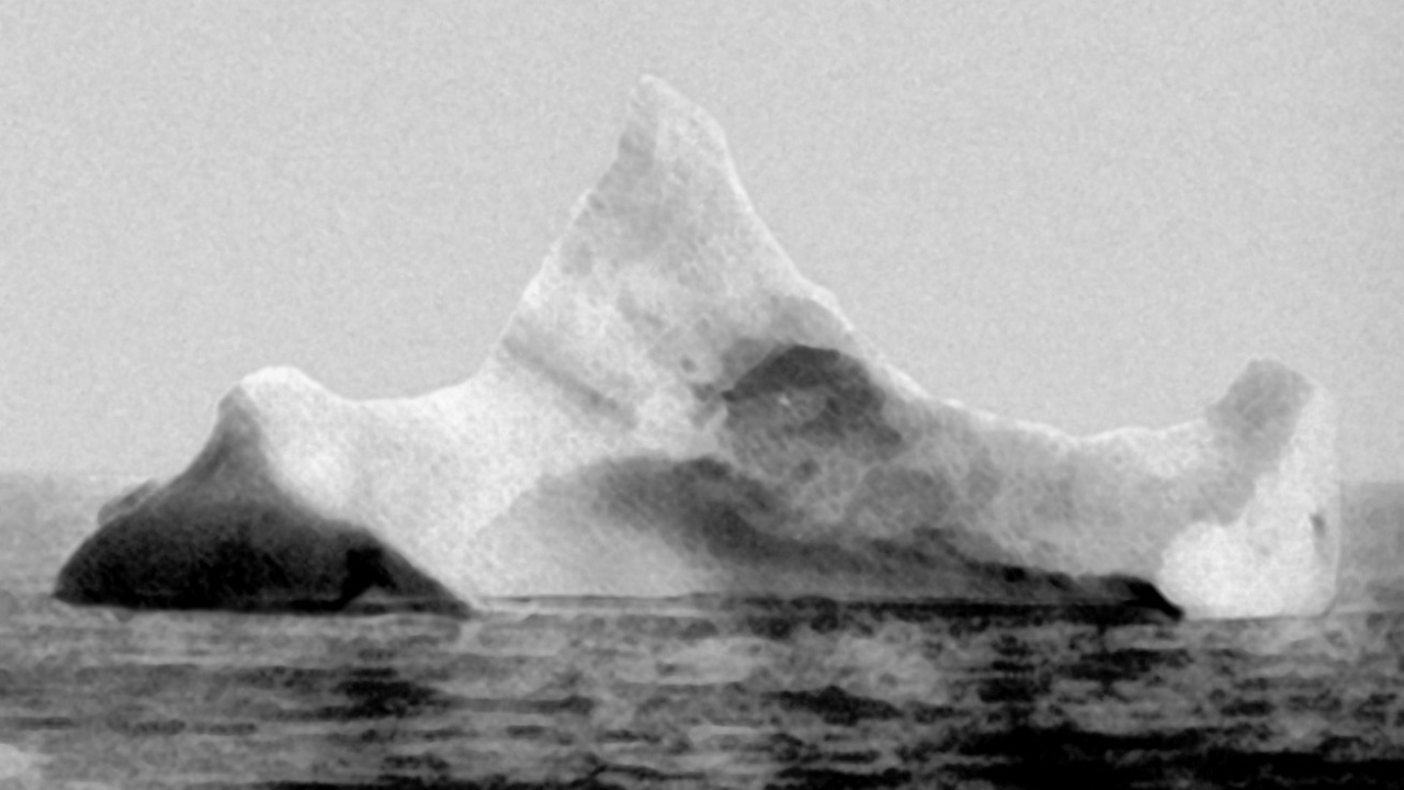 This photo, taken April 15 by the chief steward of German liner  SS Prinz Adalbart . Sailing just a few miles away, he hadn't yet known of the  Titanic  tragedy, but he did observe an iceberg with a red paint streak along the waterline; telltale signs of a very recent collision.