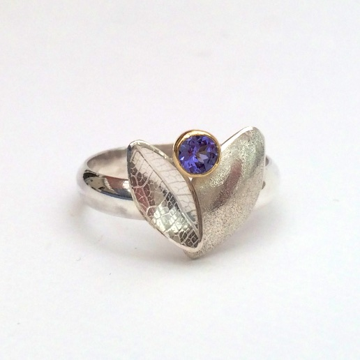 Tanzanite set in 18 carat yellow gold on silver band with silver leaf duo shapes