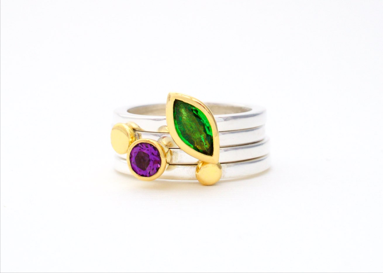 Silver, 18 carat gold, amethyst and tsavorite garnet rings