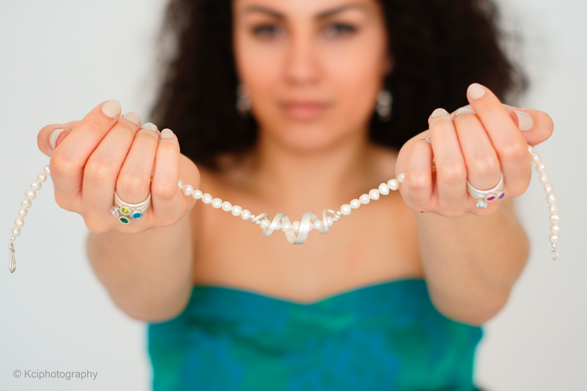 Pearl swirl necklace and scattered trillions stacking rings