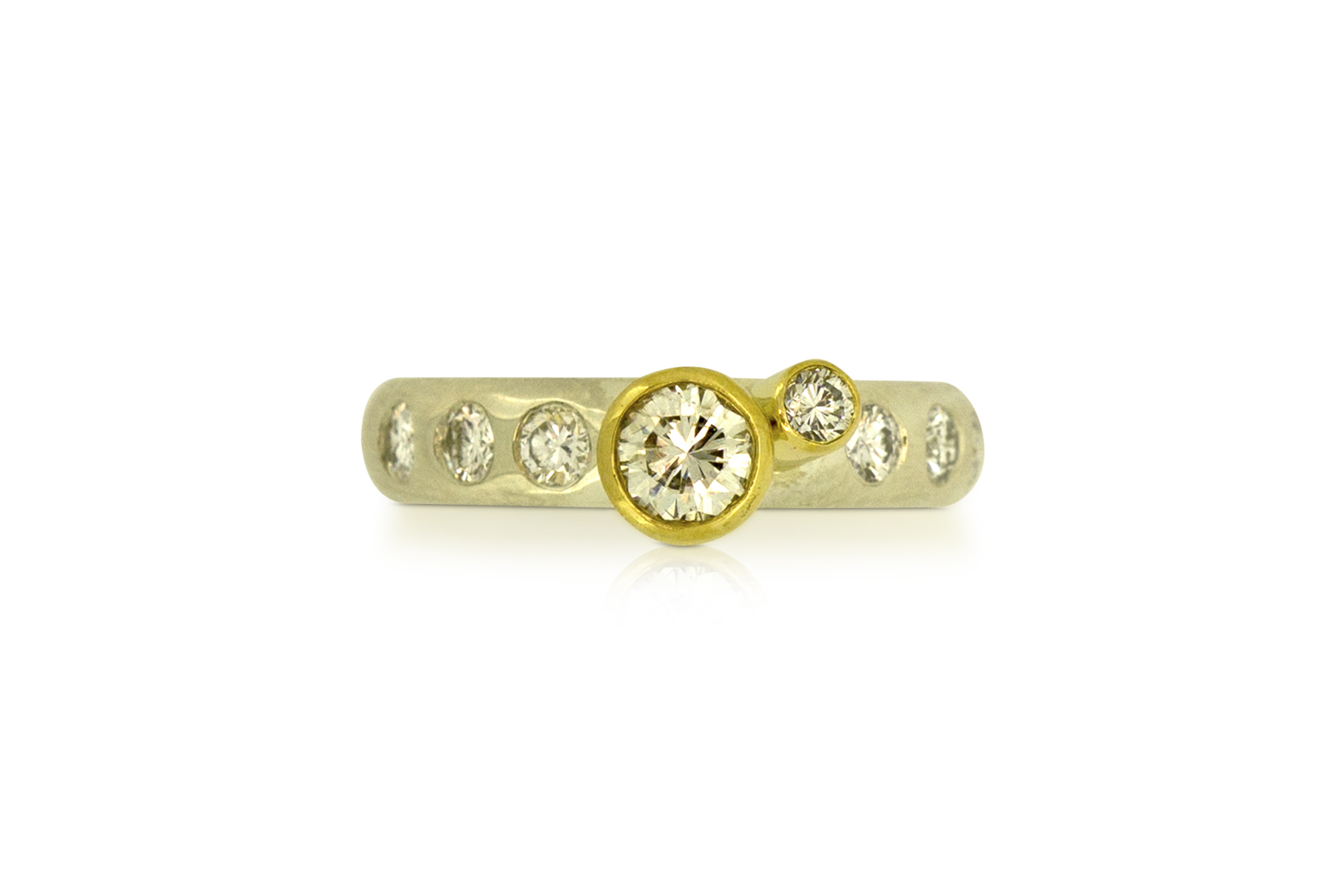 New ring with 8 diamonds set in it.  18 carat yellow gold settings and 9 carat white gold band.