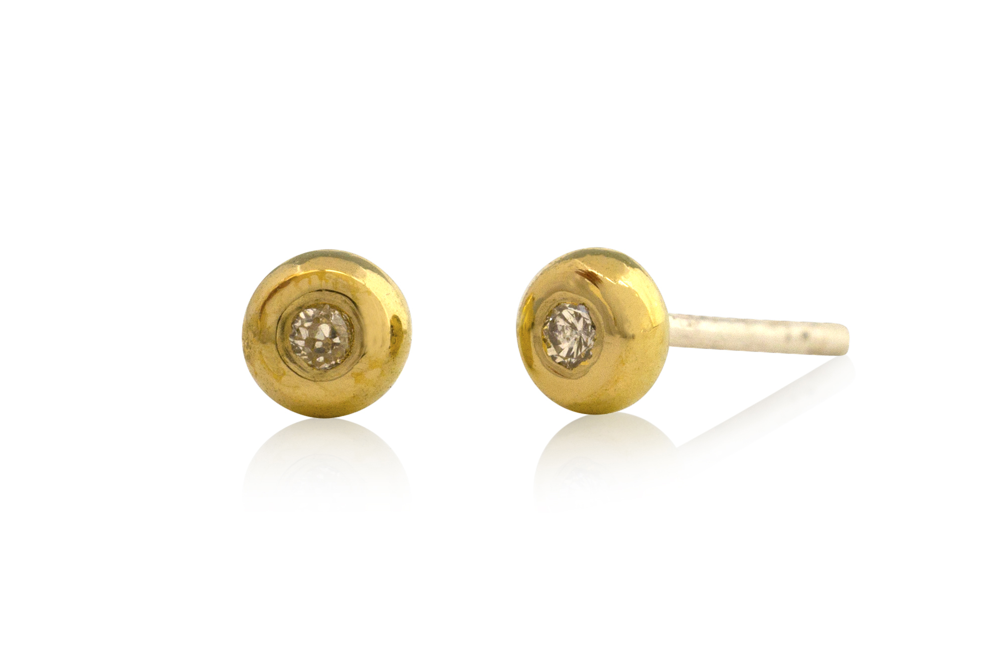 Left over gold and diamonds from the original ring were made into stud earrings.