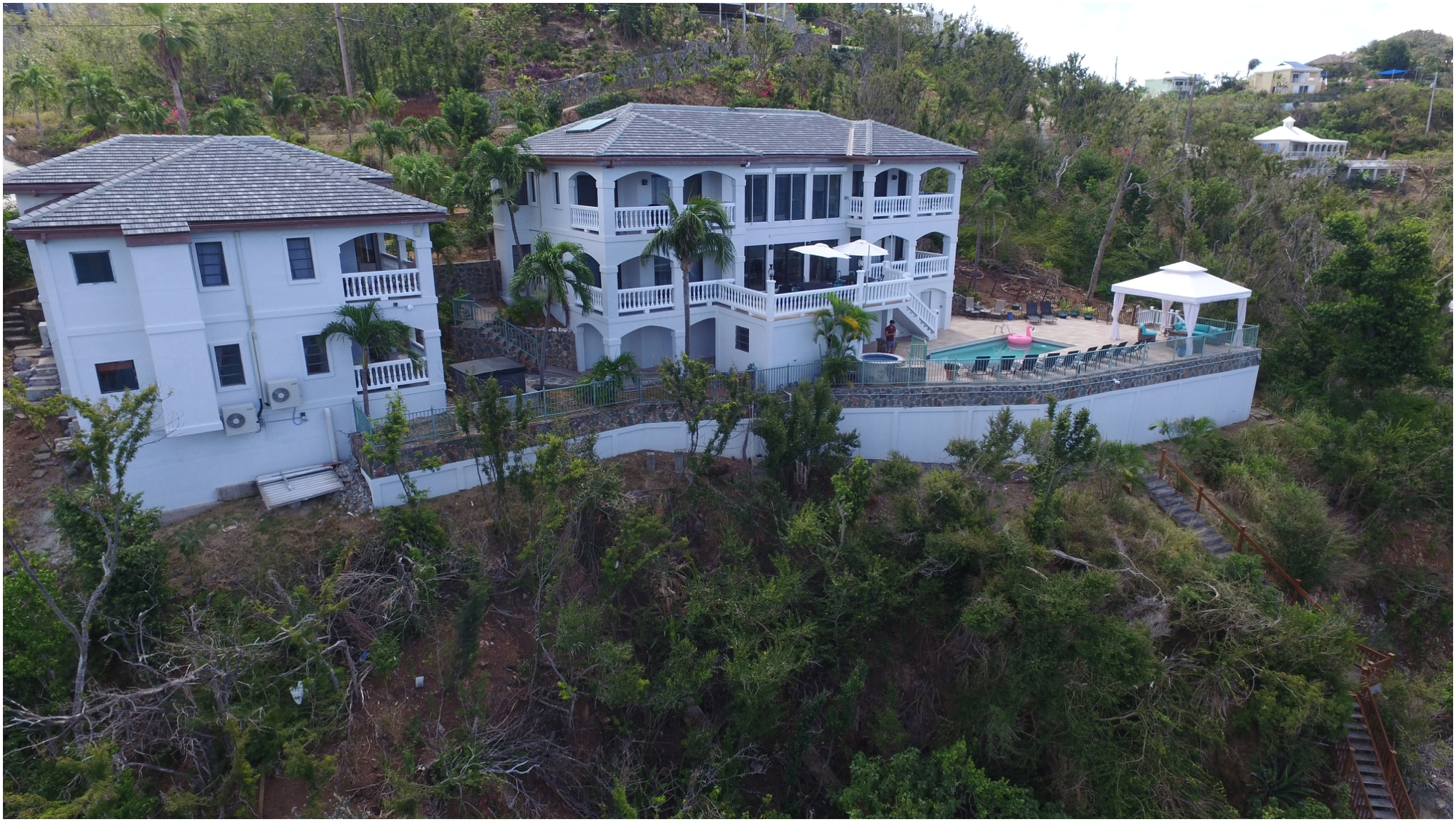This home lost 90% of its roof, all of it's interior walls and the floors were terminally damaged. Unique Island Assets proudly oversaw the restoration and completed a $1M remodel in just 4 short months, 2 of them without electricity and challenging supply logistics. The home re-opened for business March 17th with celebration. We have tremendous gratitude to the over 100 local workers who assisted in this heroic effort and its contribution to our economy.