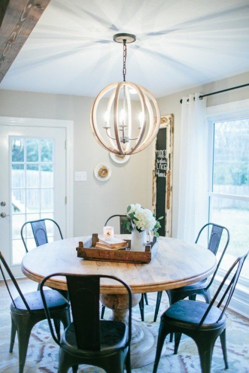 The Magnolia look: beautiful wood globe chandelier glowing beautifully above the round family table.     Photo from: Magnolia Market