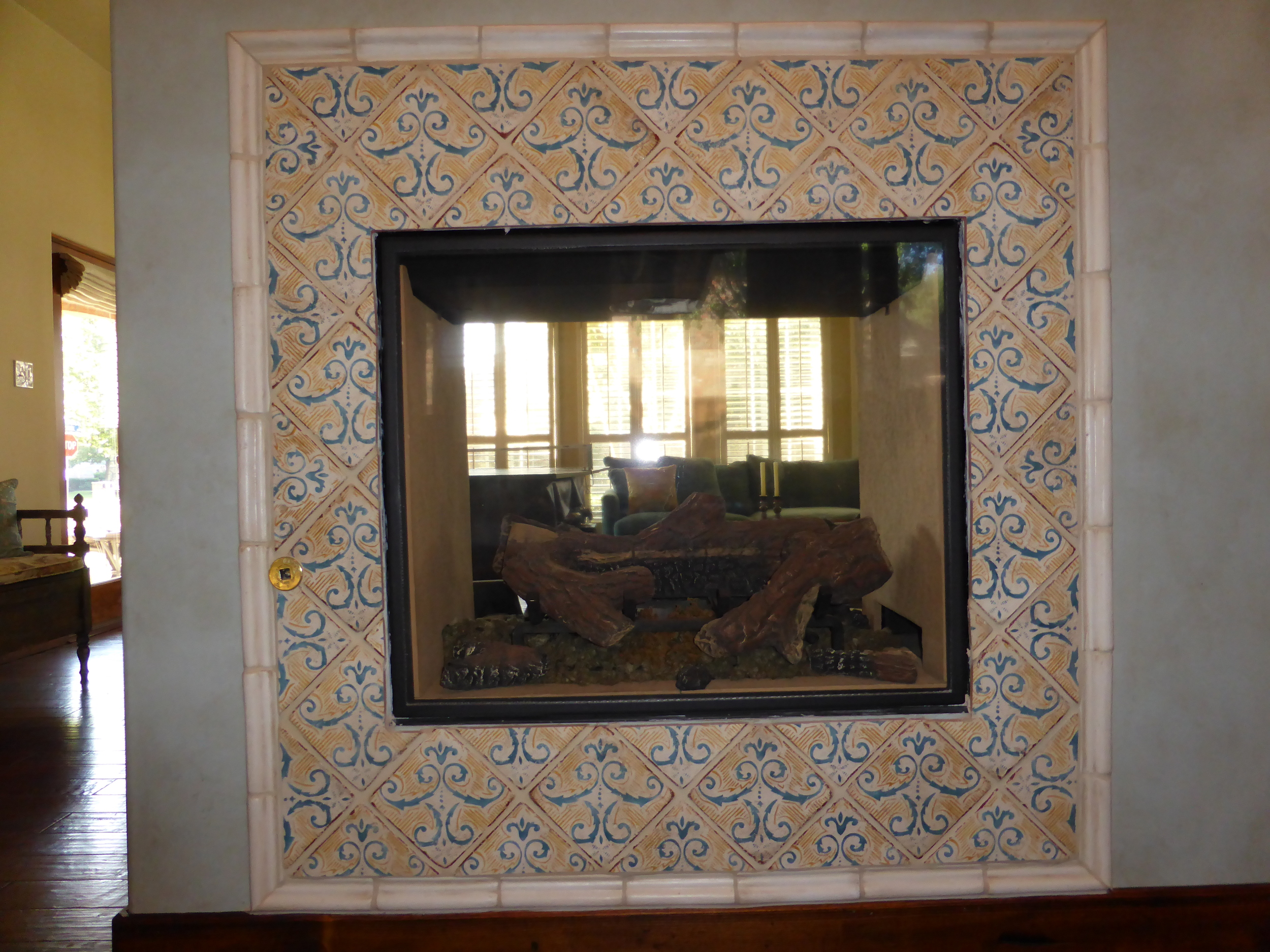 This was just a wall. Now it is a see-through fireplace. We busted it out so we could enjoy it from the kitchen nook. Just the push of a button.