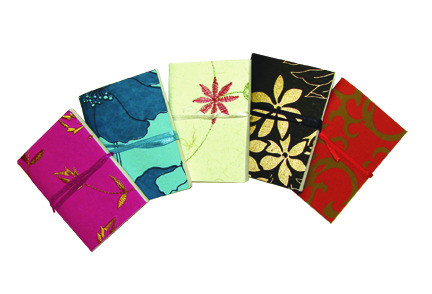 Mini recycled cotton journals, perfect for keeping in your purse made by  Eco Friendly Papers  in  India