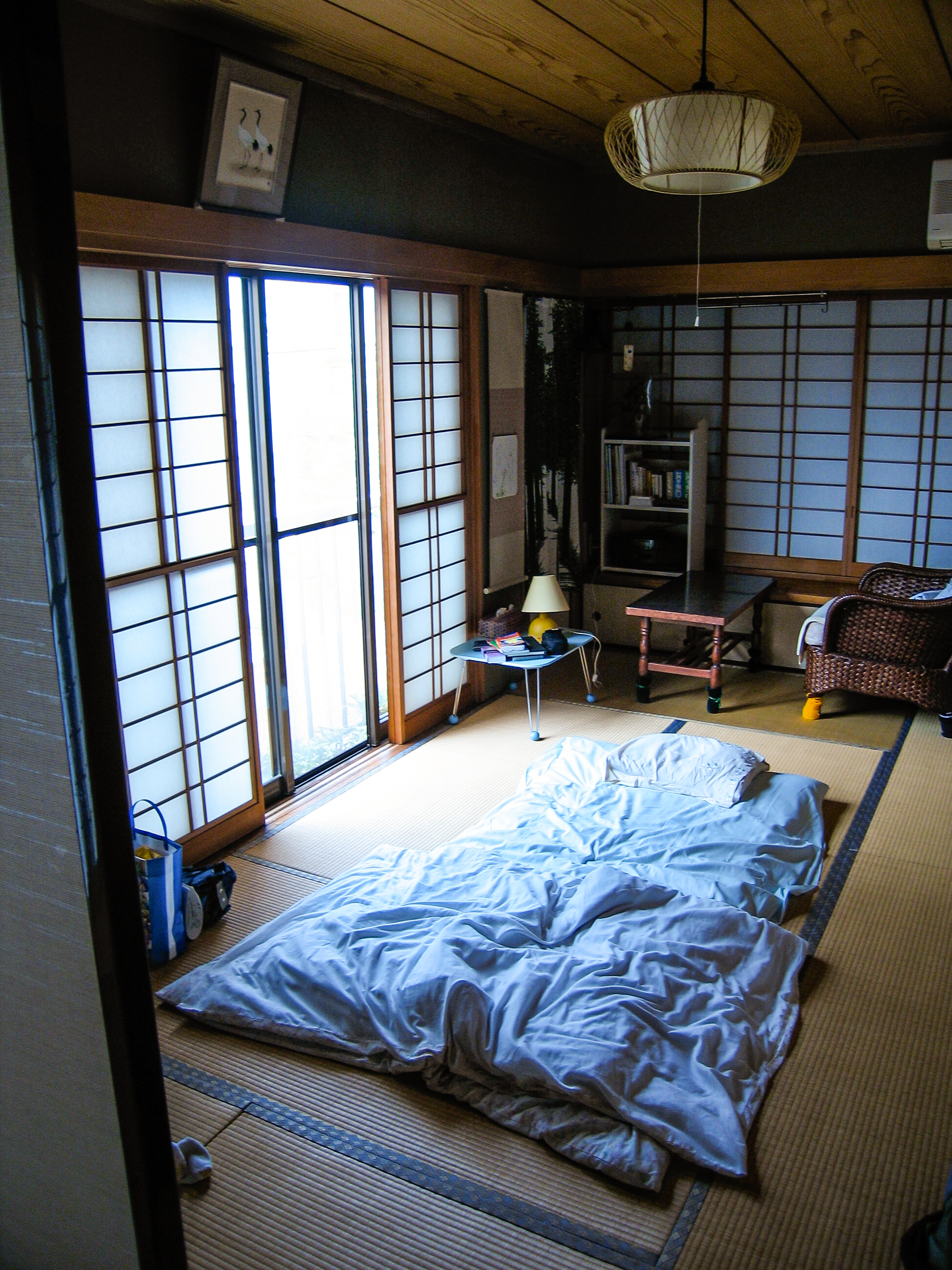 Futon in tatami room at dawn at my first host's home.