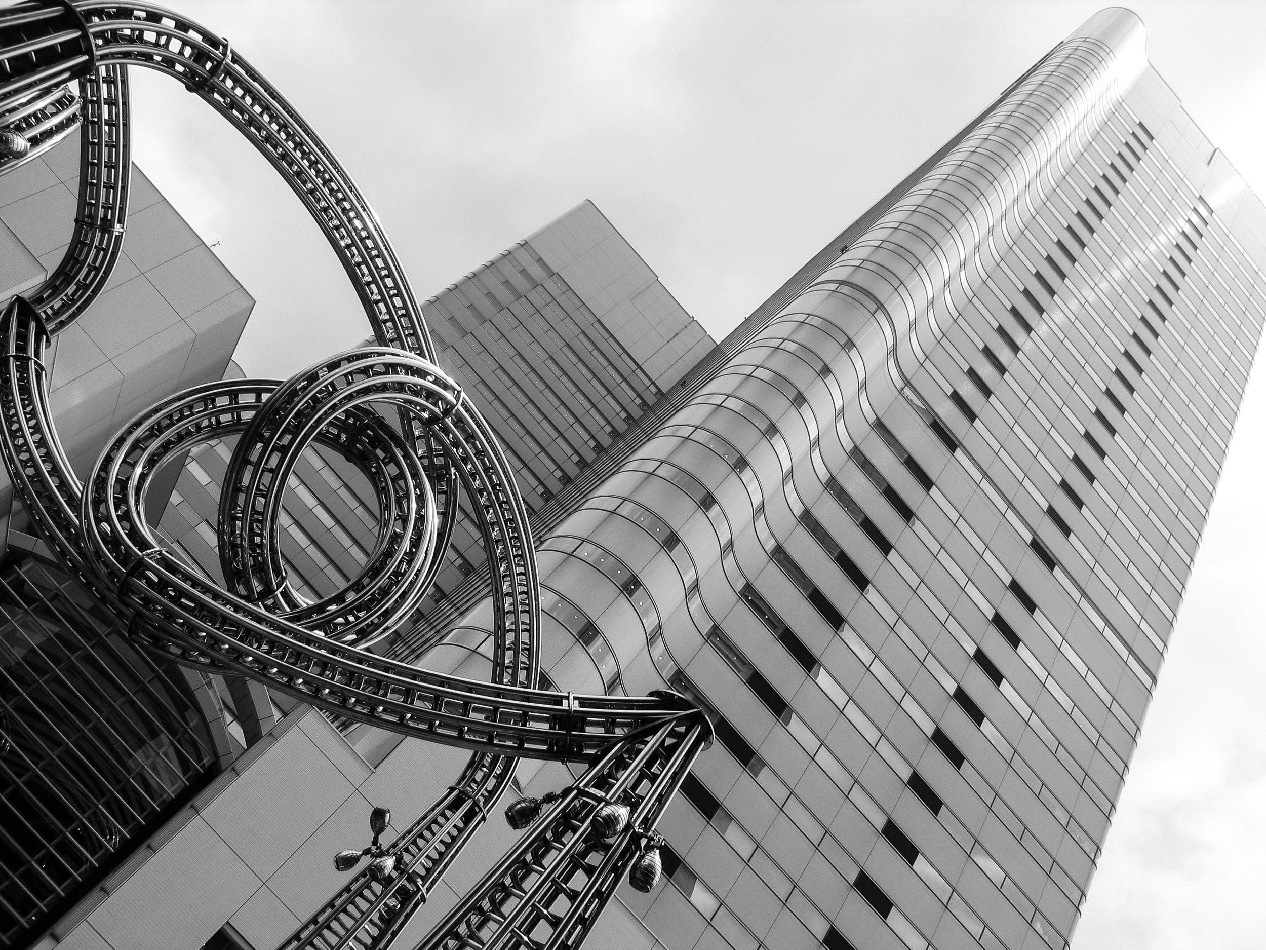 "The gigantic steel sculpture ""MokuMoku WakuWaku Yokohama YoYo"" (Hisayuki Mogami,1994) in front of the building adjacent to Landmark Tower, Japan's fourth tallest and Yokohama's tallest building."