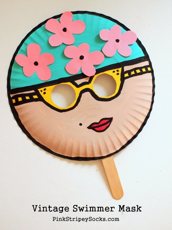o make the mask, I simply cut out two holes for the eyes.  Then I painted a face on the front of the   paper plate   and cut out some flowers from   construction paper . Then I glued on the flowers and taped on a    jumbo popsicle stick   to the back of the paper plate.