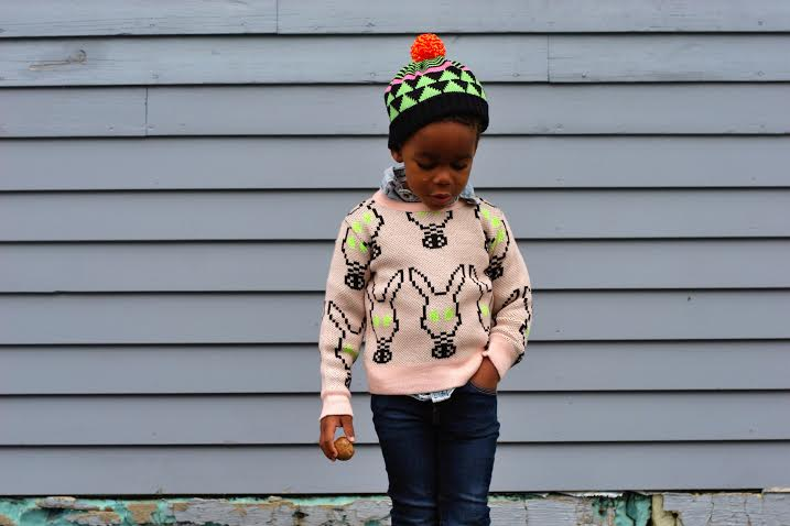 My little bunny wears: Mask knit jacquard sweater by Caroline Bosmans  ,  Black triangle striped beanie by All knitwear  ,  Skinnies by Esp Jeans  ,  Knight shoes by Akid  ,  Happy sunnies by We are Sons and Daughters