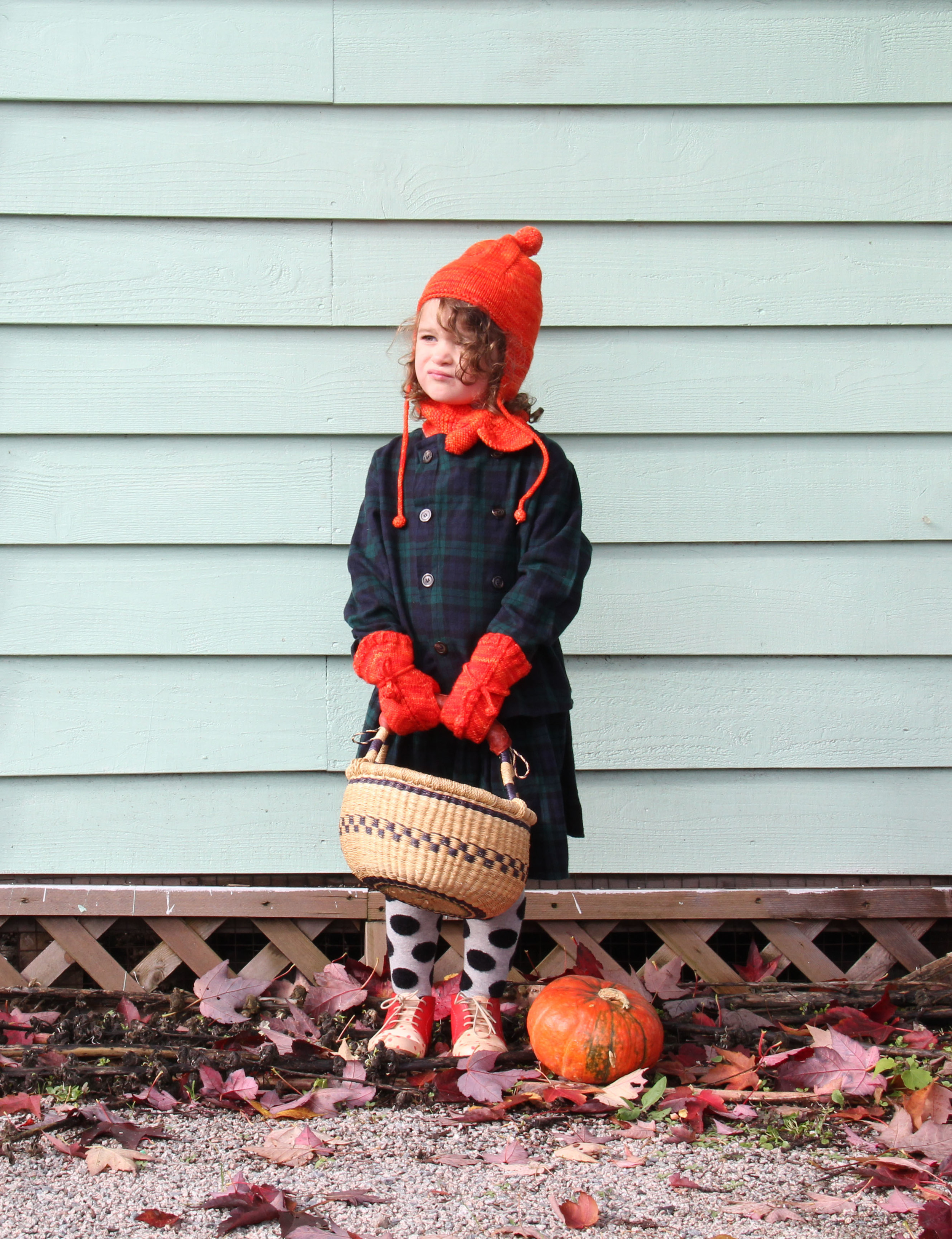 Misha and Puff Pointy Peak Hat  |  Sledding Scarf  |  Snowshoe Hare Mittens in Persimmon  |  Nico Nico Ramsey Button Down  |  Wynona skirt in Forest Plaid  |  Hansel from Basel Polka Dot Tights  |  Nathalie Verlinden Mingus Booties