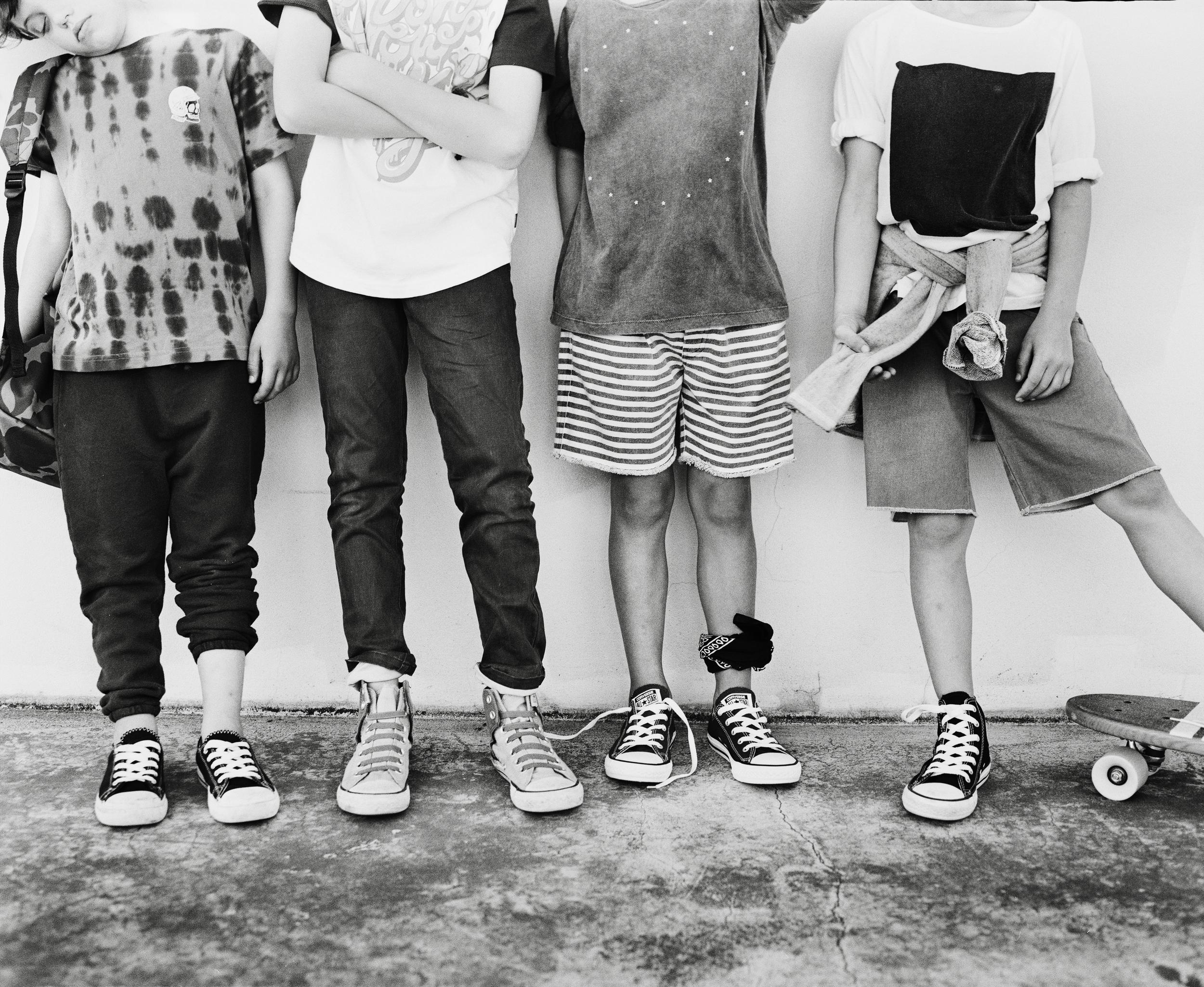 Harley wears: Munster tee   Nico Nico pants His own shoes Vans backpack   Kai wears: Munster tee andJeans   Converse hi tops  His own bracelets  Kody wears: Zuitton shirt andshorts  Converse low  Stylist's own bandana (worn on leg)  Joe wears: Zuitton tee   Nico Nico jumper  (worn around waist) Munster shorts   Converse hi tops   Worthy Skateboard
