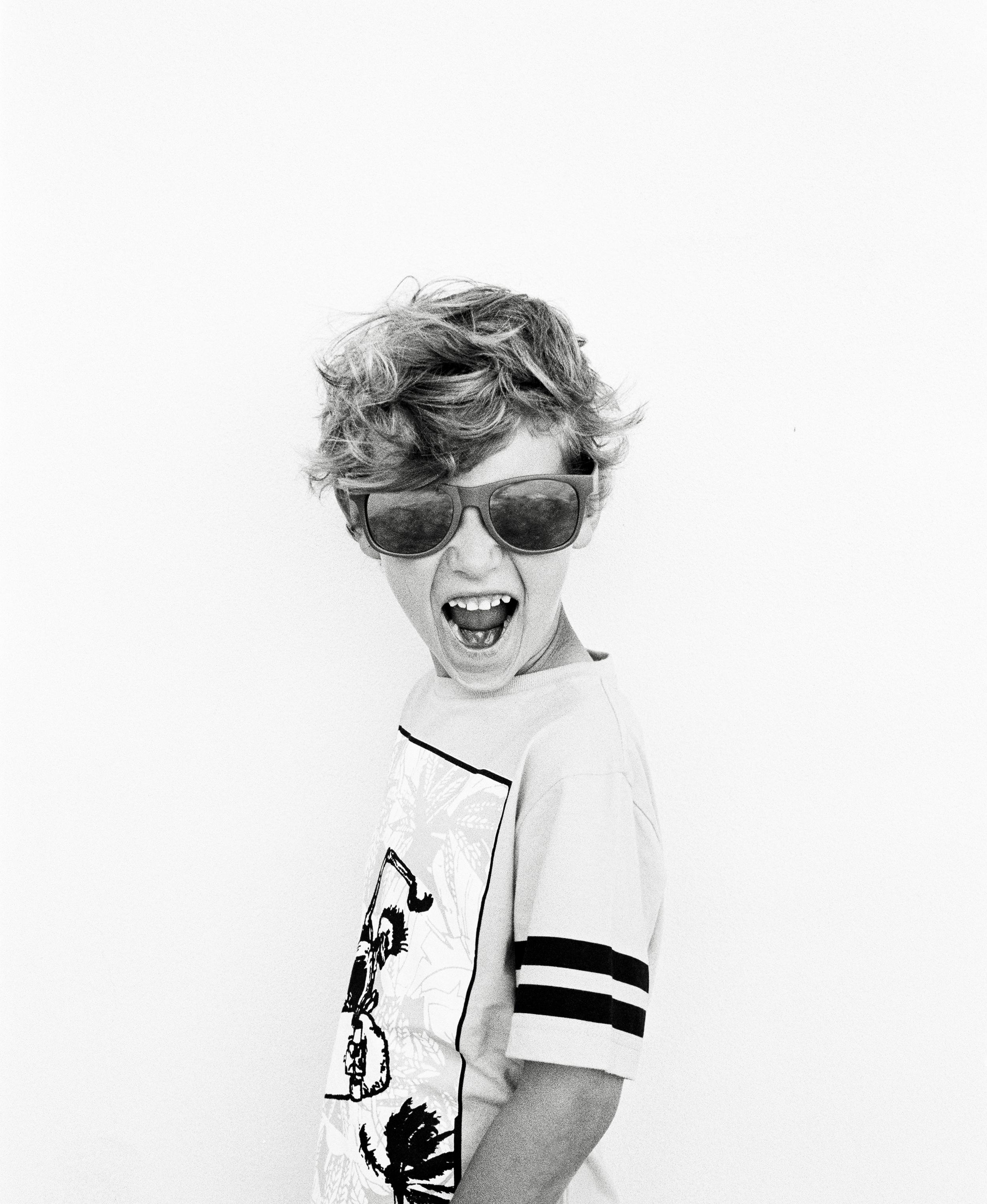 Kody wears: Munster tee  Vans sunglasses