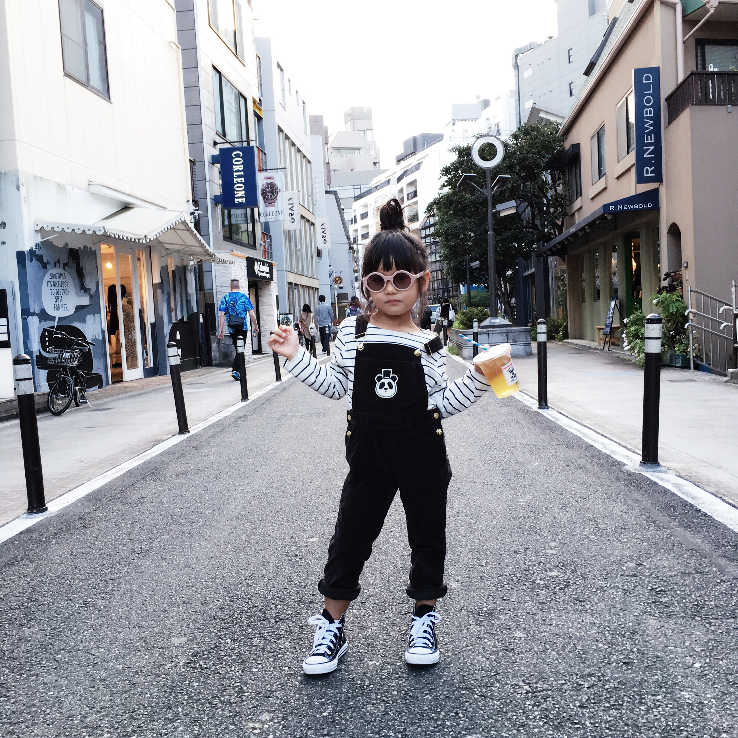 In the middle of CAT STREET in Harajuku: Shirt:  Emile Et Ida  from  Minou Kids , Overalls:  Mini Rodini  from  Minou Kids , Sunnies:  Winkniks , Sneakers: Converse