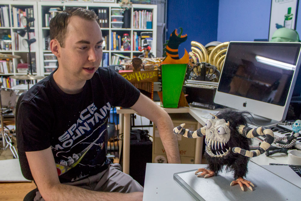 Josh Funk with the star of his next stop motion film, an as-of-now unnamed monster. Photo credit: Ernesto Rivera