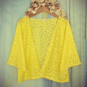 A brightly colored bed jacket, photo via Mansfield Lingerie Instagram.
