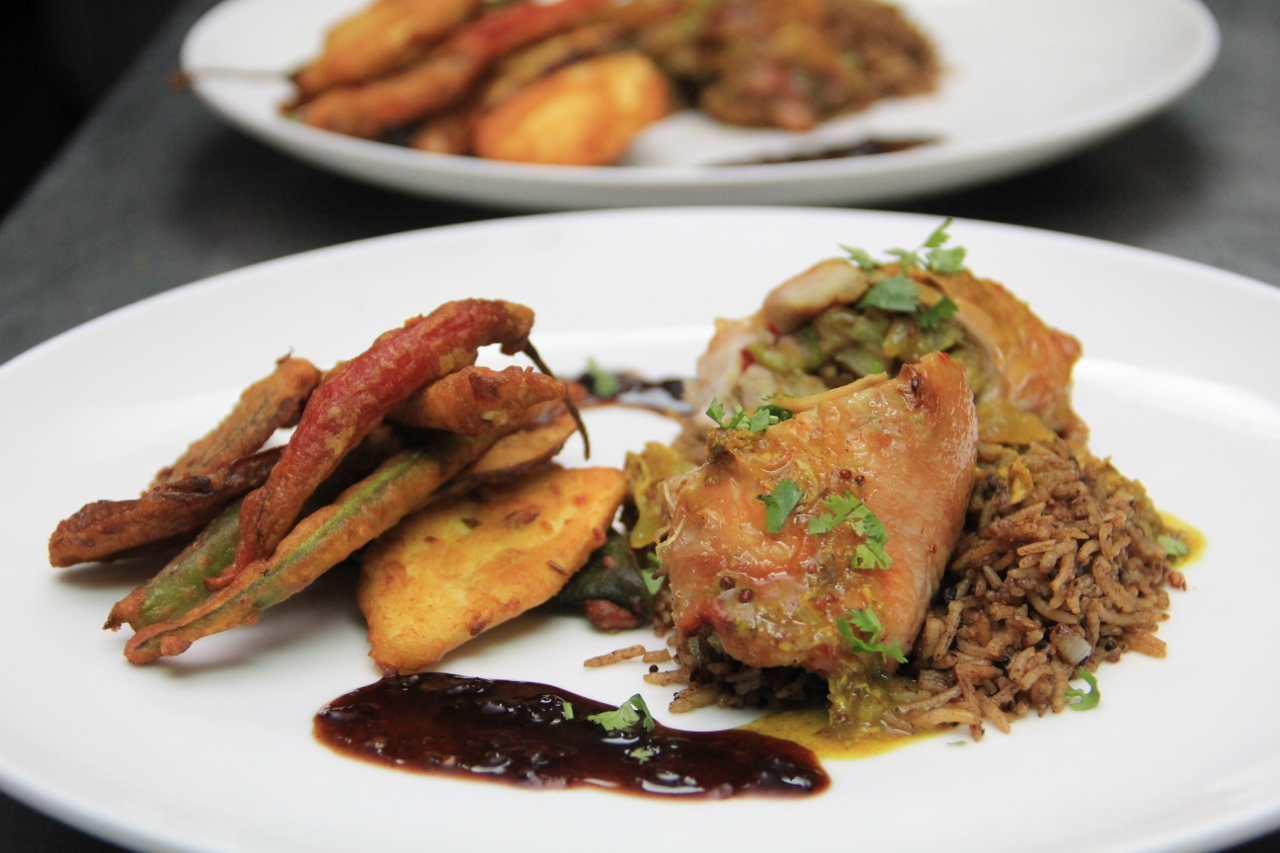 Contemporary chicken curry with tamarind rice and bhajia