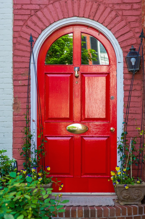 While it lacks the elegance of the perfect transition, this simple entry door successfully moves us from streetscape to home mode in seconds.