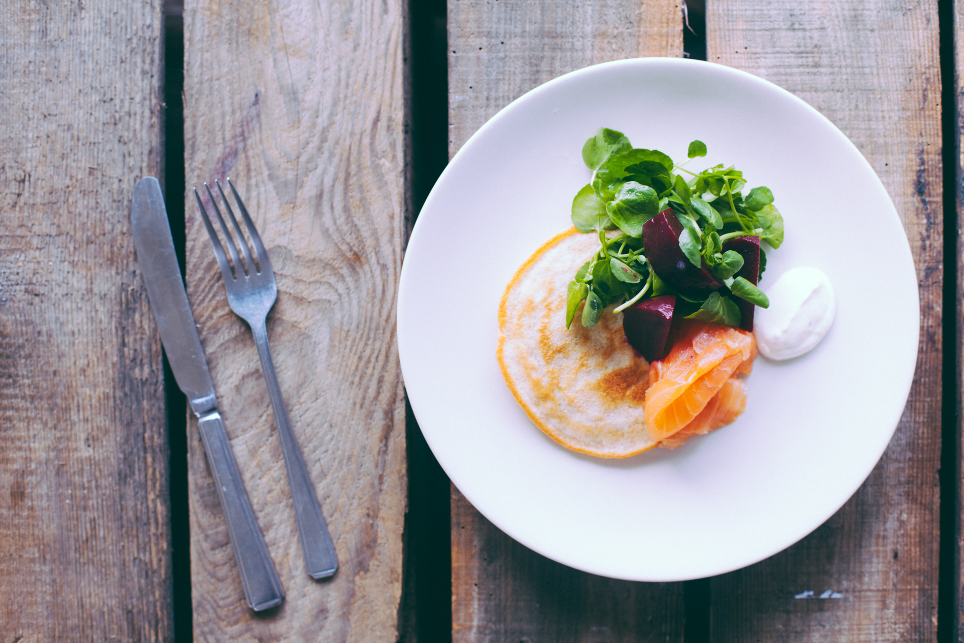 Scottish pancakes with smoked salmon, horseradish  Crème fraîche , watercress and pickled beets.