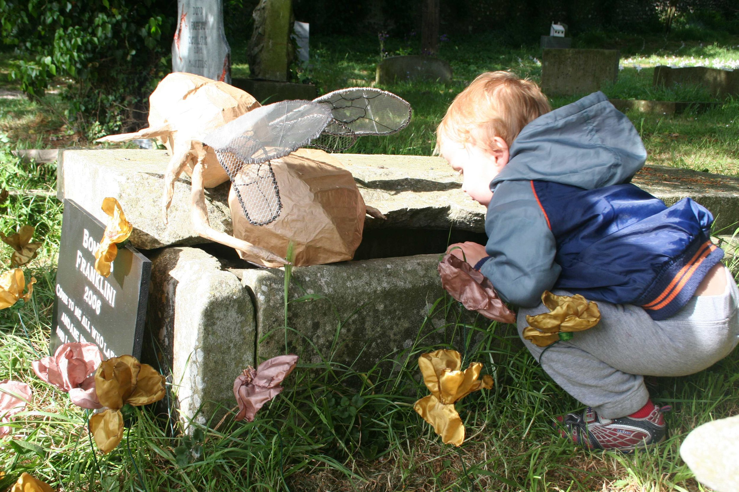 A child visits the 'grave' of Bombus Franklini during the Funeral for Lost Species.